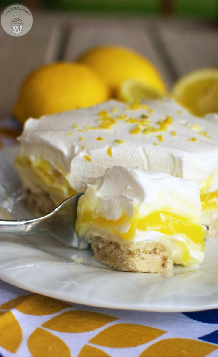 A cookie crust is layered with a creamy lemon pudding, sweet cream cheese, and a fluffy whipped topping. This dessert is perfect for spring and summer!
