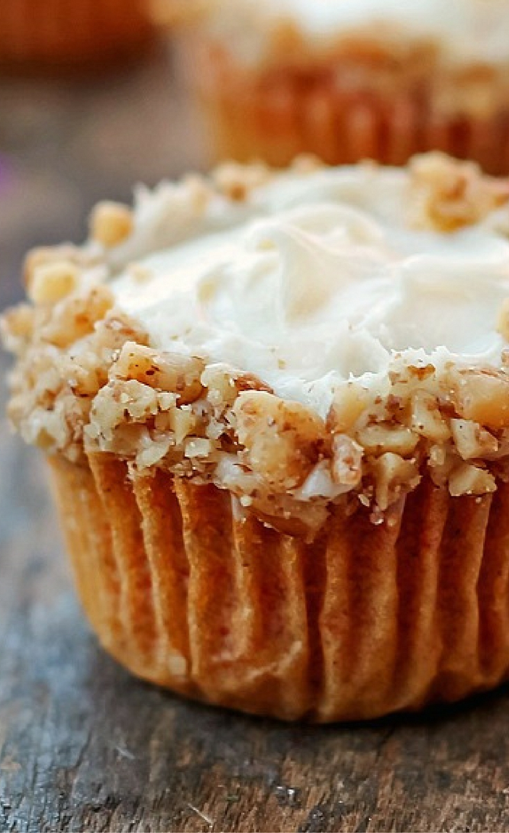 This is a moist carrot cake cupcake with a little dollop of pineapple flavored cream cheese in the center. It's topped with a cream cheese frosting and decorated around the edges with chopped walnuts.
