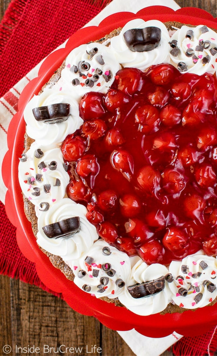 This Chocolate Cherry Mousse Tart has layers of rich chocolate fudge, creamy cherry mousse, and sweet cherry pie filling.