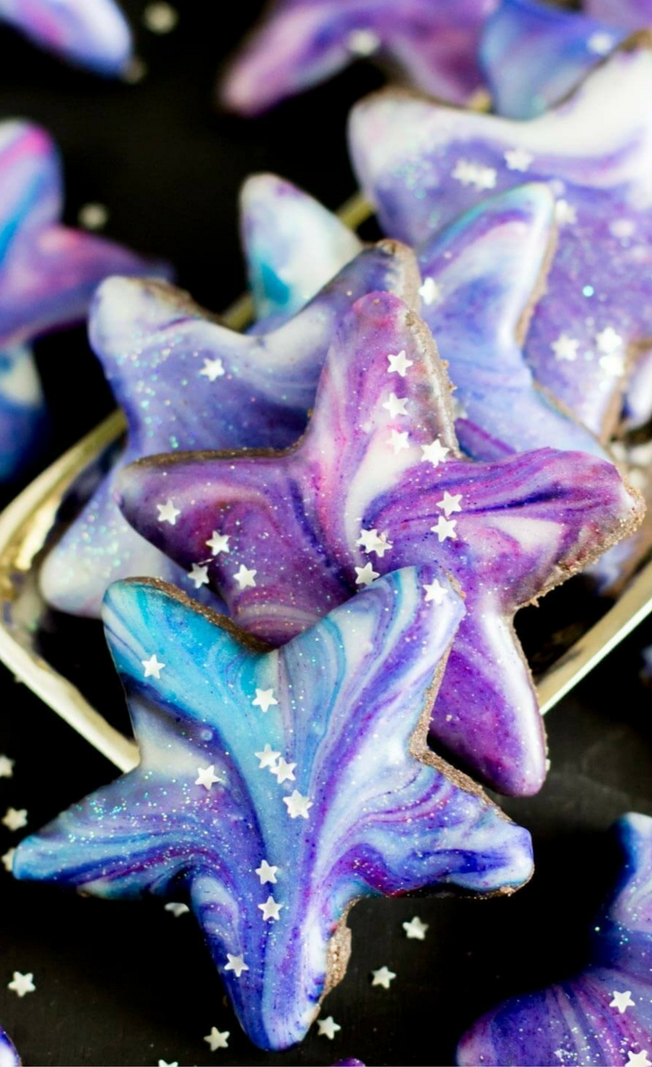 Galaxy Cookies: Star shaped cutout cookies with a galaxy glaze.