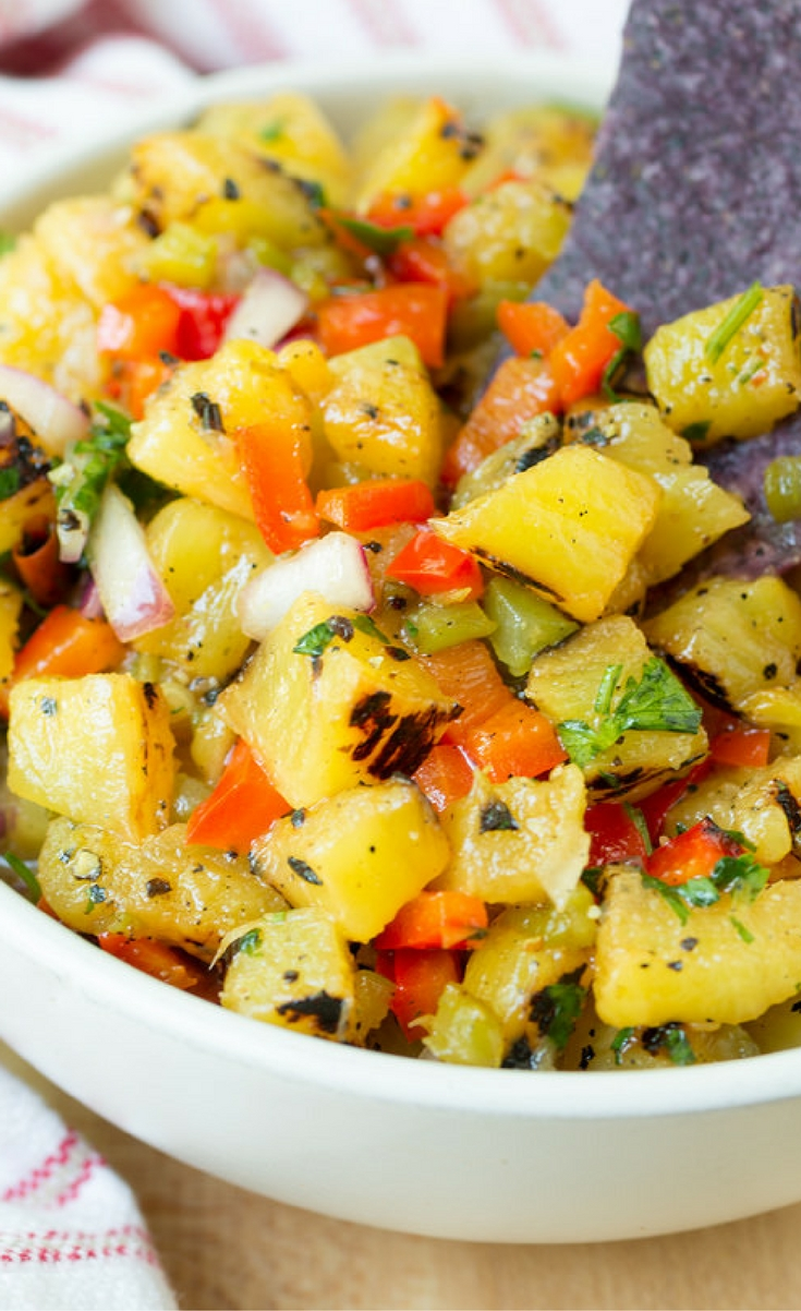Sweet and smoky with a hint of spice, Grilled Pineapple Salsa is a delicious summer snack with chips, or served alongside grilled meats and seafood.