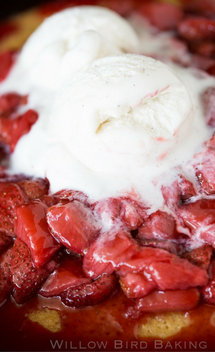 A gorgeous, easy, surprisingly delicious hot yellow cake recipe topped with sweet roasted strawberries and vanilla bean ice cream. A must-make recipe for summertime on the patio!