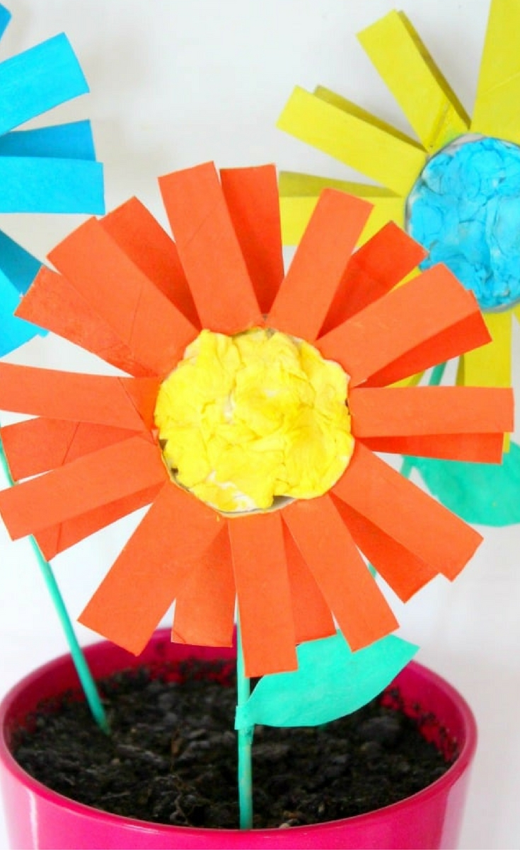 Wanna help your kids develop their artistic and motor skills? Try and make this paper flowers kid craft together for a fun family activity you'll all enjoy!