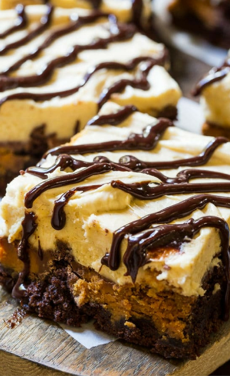 These fudgy Peanut Butter Cup Brownies have a layer of peanut butter cups baked into them and are covered with a light and luscious peanut butter frosting and then drizzled with melted chocolate.