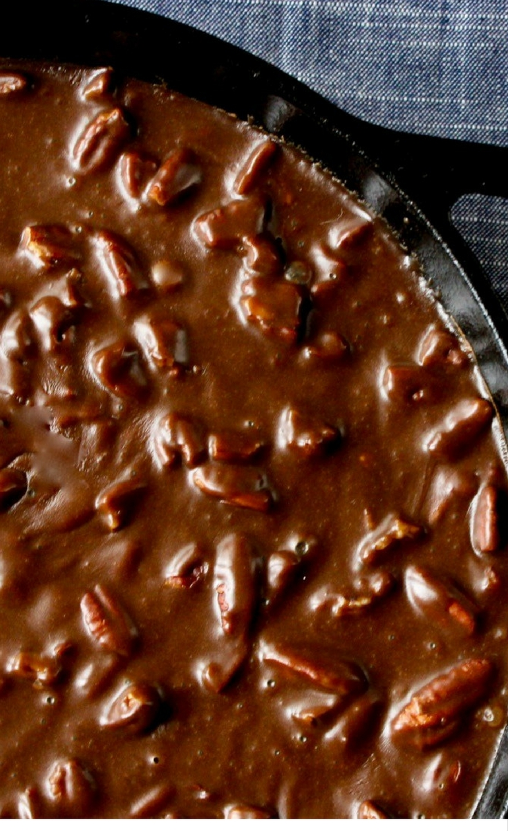 Classically decadent Texas Chocolate Sheet Cake with a fudgy, pecan-studded chocolate frosting made in a cast iron skillet.