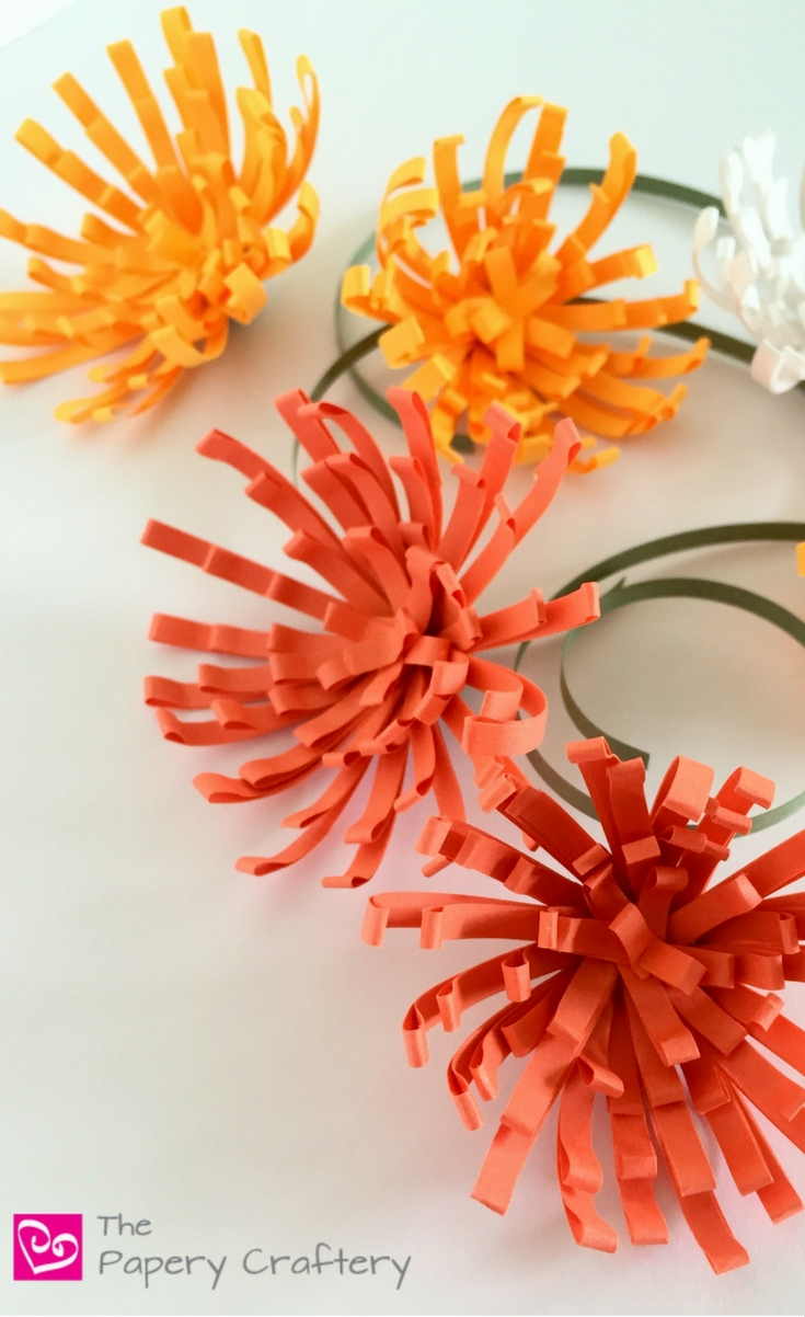We're starting to see fall flowers around our town and so I was inspired to tackle making my own quilling paper mums.