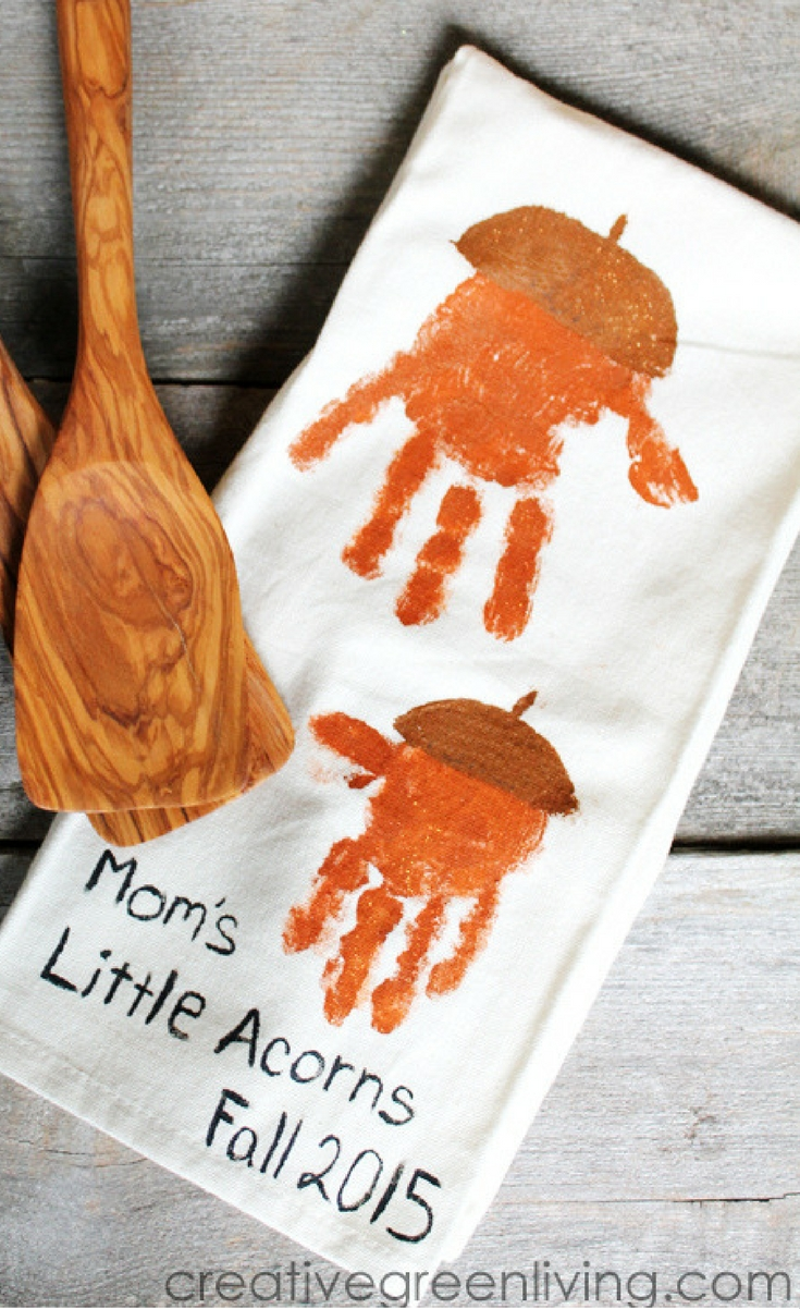 We made handprint acorns stamped onto kitchen towels. I think they are super cute.