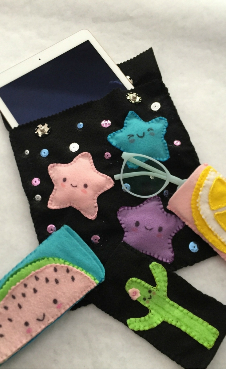 This super easy craft can be made in less than an hour and is easy enough for tween's to do. All you need is to know one simple stitch to complete the whole pouch ORjust glue it all together. I used a combination of glue and stitching to achieve the look I was going for.