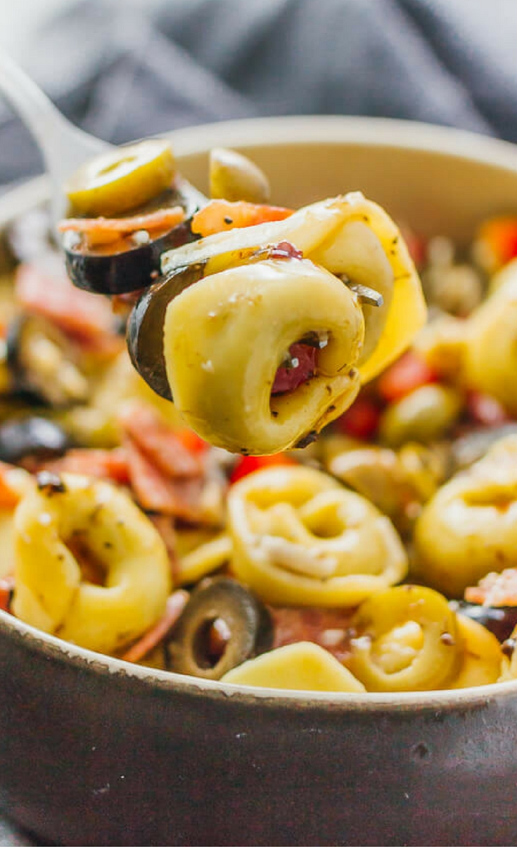 This tortellini pasta salad with Italian dressing is a quick and easy recipe, deliciously packed with mixed olives, salami, and cheese.