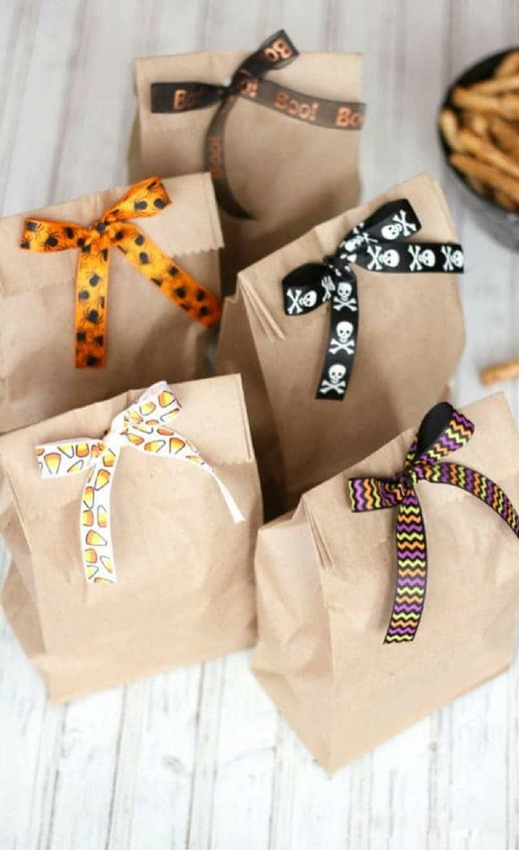 This is probably one of the cutest (and easiest) crafts I've posted! I get tons of compliments on these little homemade treat bags! This kids idea is from Kristine In Between.