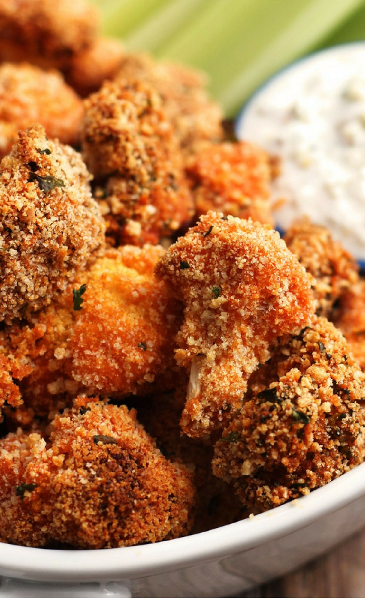 Buffalo Broccoli and Cauliflower Bites are a healthier vegetarian appetizer full of spicy bold flavor. Your meat-eating friends and family will love this addictive crispy snack.