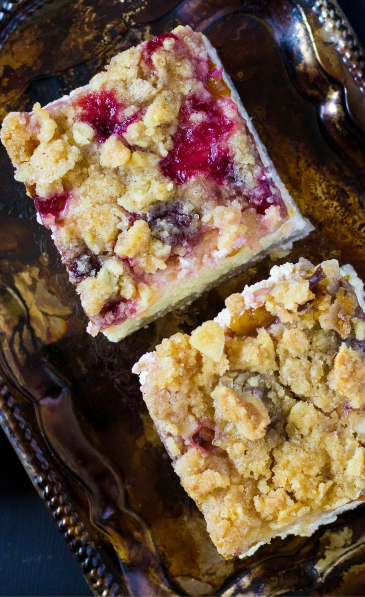 Fall dessert with kneaded dough, cream cheese filling, plums and crumble.