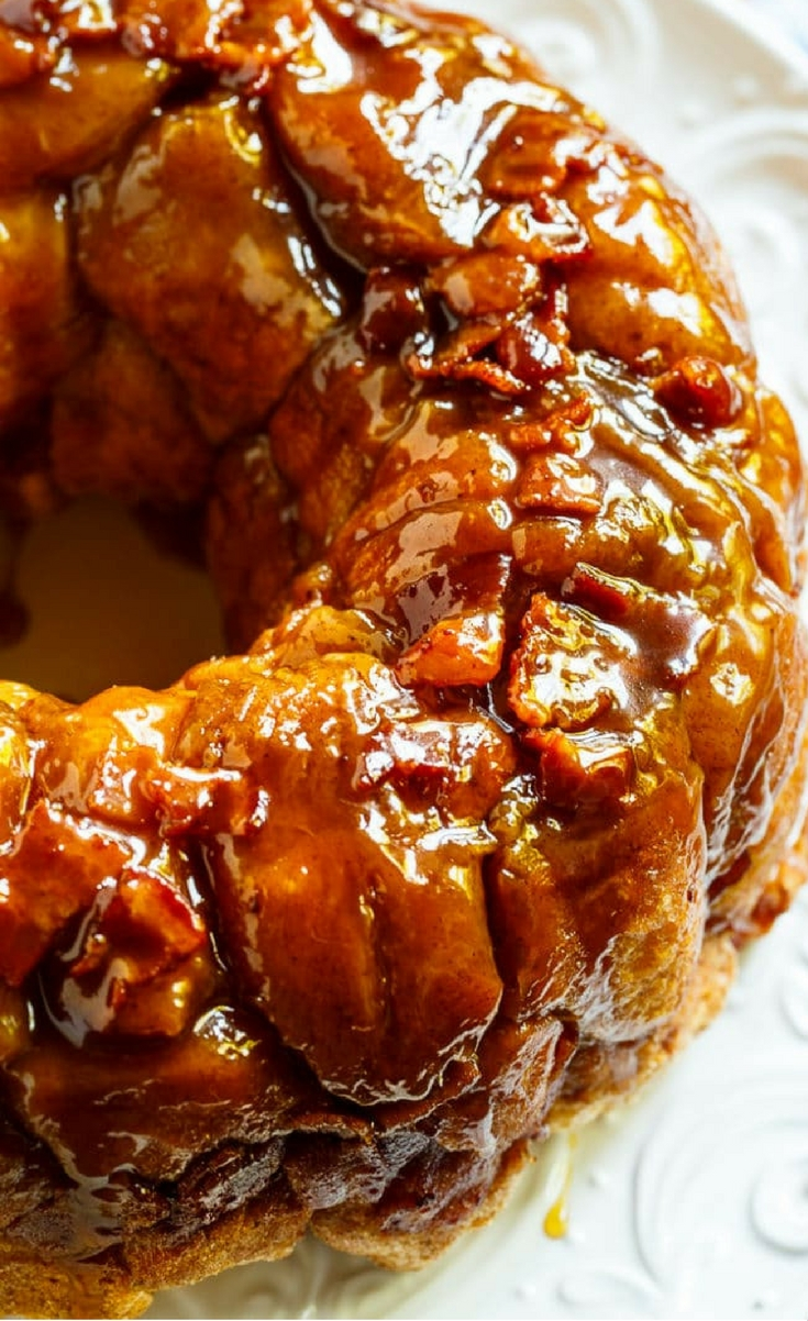 Bacon Maple Monkey Bread is gooey and sweet with salty pieces of bacon throughout. Made with refrigerated biscuit dough, this easy to make Monkey Bread has a delicious mix of sweet and salty. It is wonderful for holidays and brunches.