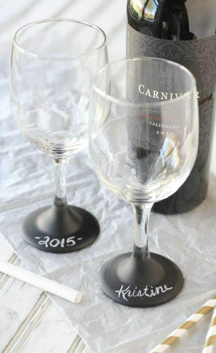 These wine glasses are probably oneof my favorite little projects ever because you know me, I love to chalkboard paint anything/everything and i adore anything personalized. And they're so easy to make!