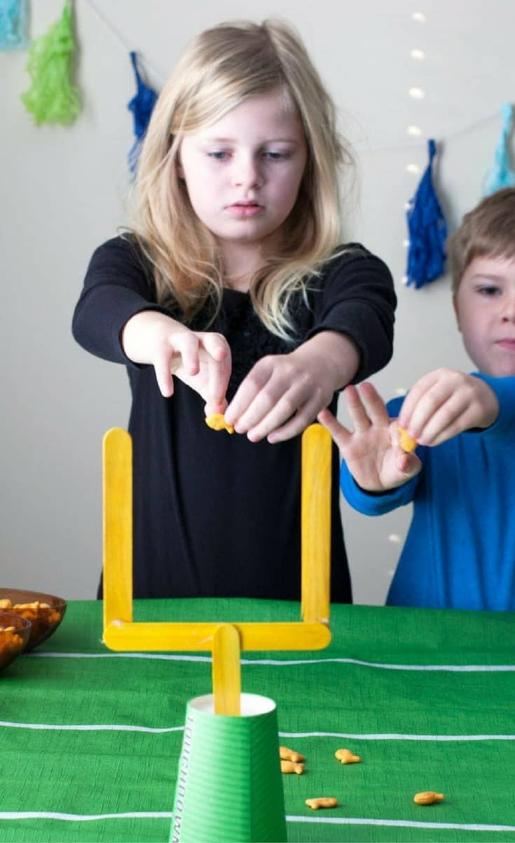 Game day can be fun for you and the kids with this easy game day craft stick field goalGoldfish® crackers game.