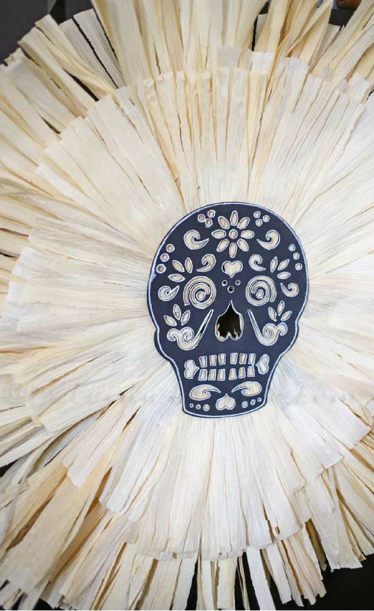 Fun Halloween crafts like this Sugar Skull Corn Husk Wreath make it easy to decorate for the holiday. It's simple & festive & perfect Halloween decor.