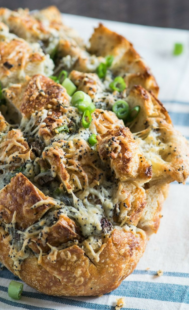 This cheesy pull-apart bread appetizer is a cheese lover's dream and is guaranteed to be a crowd-pleaser at any party!