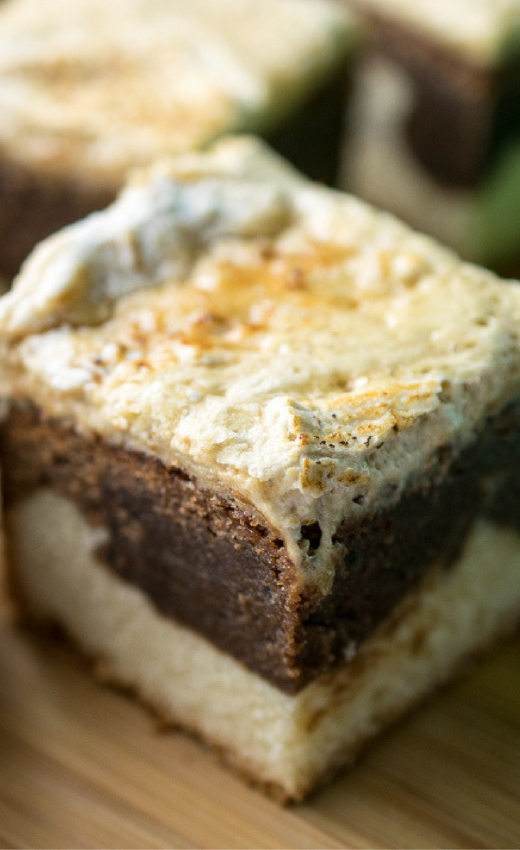 Thick and rich fudgy chocolate brownies with a vanilla cookie base and toasted marshmallow top.