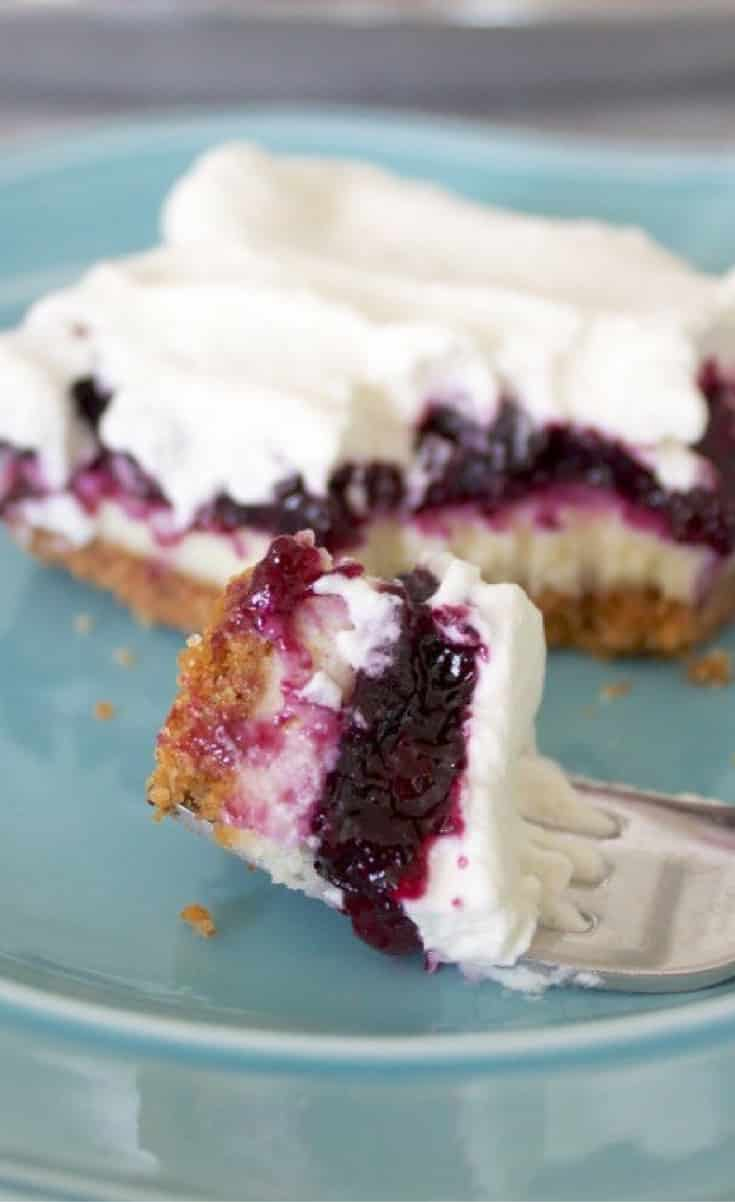 Blueberry cheesecake bars are layer upon layer of happiness – buttery graham cracker crust, a layer of cheesecake that's thin enough to let the other flavors shine but rich enough not to get lost, sweet-tart blueberry pie filling, and fluffy whipped cream.