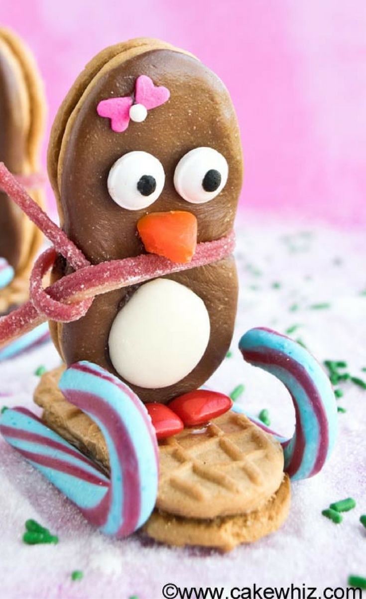 Learn how to make easy Nutter Butter sledding penguins, using this step by step tutorial. Fun edible craft for kids during Christmas and Winter time!