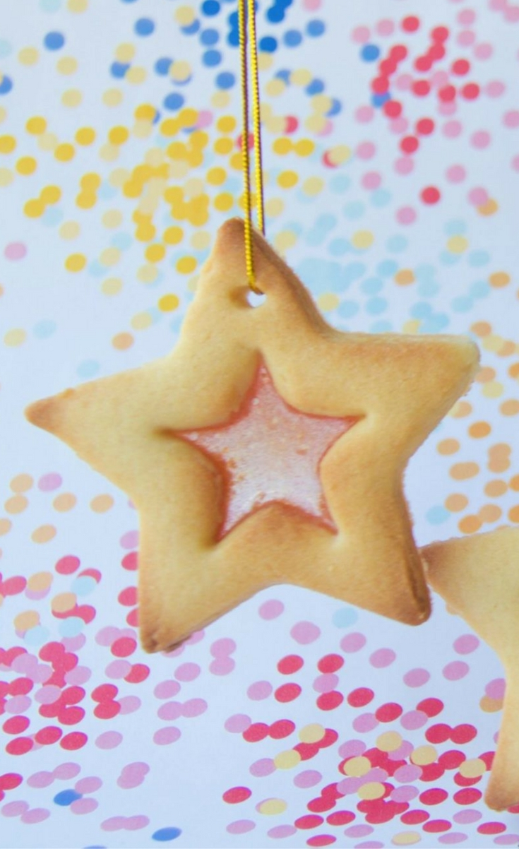Stained glass window biscuits are a childhood Christmas classic and the way the boiled lollies transform into stained glass is a little bit of kitchen magic! Use them as edible gift tags for something a little out of the ordinary.