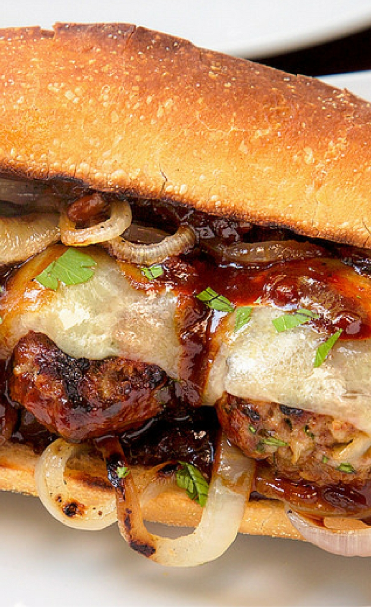 Grilled Meatball Subs layer lightly-charred meatballs with grilled onions, BBQ sauce, and melted cheese onto crusty rolls for a bold take on a classic.