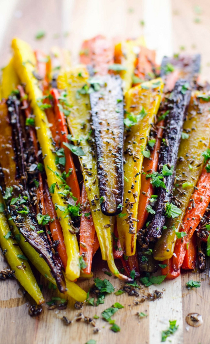 Rainbow carrots make a great winter holiday side dish. They're beautiful, and the cumin and mustard seeds elevate the flavor but still play nicely with others.